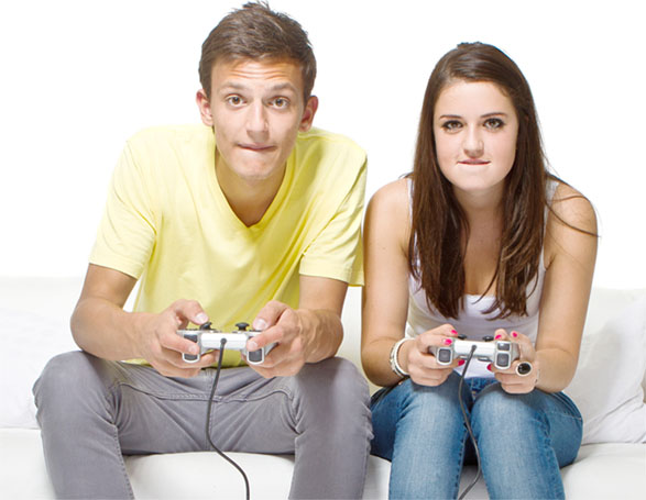 Young man and woman playing a video game